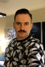 Luis Miguel Seguí con bigote en su despacho de Trece Producciones